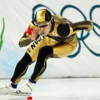 Powerful form: Keiichiro Nagashima competes in the men's 500-meter speedskating competition Monday at the Richmond Olympic Oval in Richmond, British Columbia. Nagashima earned the silver medal with a combined time of 1 minute, 9.98 seconds. | KYODO PHOTO