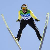 Flying high: Noriaki Kasai leaps in the qualifying round for the individual large hill event on Friday at Whistler Olympic Park. Kasai leads with a jump of 142.5 meters. | AP PHOTO