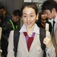 Off to Vancouver: Mao Asada leaves Narita airport on Saturday. She'll compete in the women's figure skating competition at the 2010 Winter Games, which gets under way later this week. | KYODO PHOTO