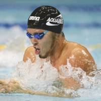 National hero: Kosuke Kitajima has won four Olympic gold medals as the best men's breaststroke swimmer of the 21st century. | KYODO