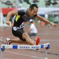 Disappointing: Dai Tamesue, a three-time Olympian, finishes seventh in 400-meter hurdle preliminaries on Friday at the National Athletics Championships in Osaka. | KYODO