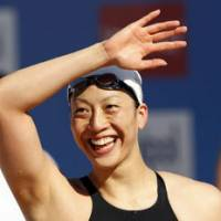 Moment to savor: Aya Terakawa flashes a smile after winning the women's 200-meter backstroke final at the Seven Hills meet on Saturday in Rome. | KYODO/REUTERS