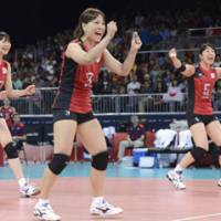 Off and rolling: Members of Japan's team celebrate after beating Algeria in their Olympic volleyball opener. | KYODO
