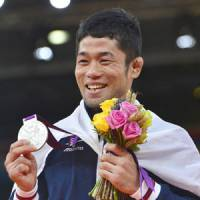 Silver lining: Hiroaki Hiraoka poses with his Olympic silver medal — Japan's first of the London Games — after the men's 60-kg judo competition Saturday. | KYODO PHOTO