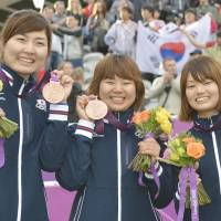 Bullseye: Archers (from left) Ren Hayakawa, Miki Kanie, and Kaori Kawanaka pose with their bronze medals on Sunday. | KYODO