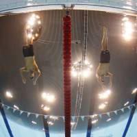Clash of the titans: Michael Phelps (center left) and Ryan Lochte (center right) start the men's 200-meter individual medley final at the London Olympics on Thursday. Phelps won to claim his first individual gold medal of the 2012 Games. | AP