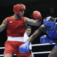History in the making: Jordan's Ihab Almatbouli (right) is the first boxer from his nation to record a win at the Olympics. | AP