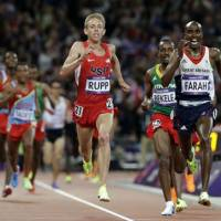 Go Mo!: Britain's Mo Farah (right) comes home to win the men's 10,000-meter final at the London Olympics on Saturday. | AP
