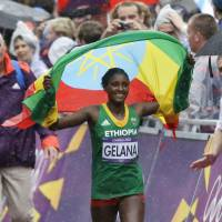The home stretch: Tiki Gelana celebrates after winning the women's Olympic marathon on Sunday in London. | AP