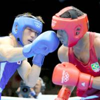 Golden touch: Ryota Murata lands a punch on Brazil's Esquiva Falcao during the final of the men's middleweight boxing competition at the London Games on Saturday. | KYODO