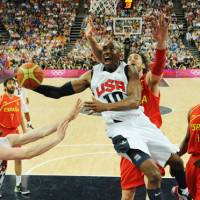 U.S. holds off Spain in final
