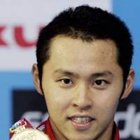 Proud moment: Kosuke Kitajima, seen after winning the 200-meter breaststroke race at the 2007 World Swimming Championships, hopes to repeat as a double-gold medalist in Beijing. | AP PHOTO