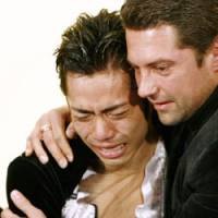 Happier times: Russian coach Nikolai Morozov hugs Daisuke Takahashi after he captured the silver medal at the 2007 world championships in Tokyo. The pair split earlier this month. | AP PHOTO