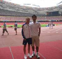 Team effort: Mara Yamauchi and husband Shigetoshi stand inside the Bird's Nest Stadium during the Beijing Games. Yamauchi, who finished sixth in the Olympic marathon, will run in Sunday's Tokyo International Women's Marathon. | MARA YAMAUCHI PHOTO