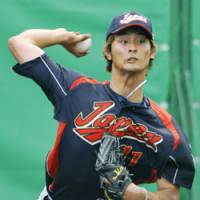 Young gun: Hokkaido Nippon Ham ace Yu Darvish is one of five pitchers who are 25 years old or younger on Japan's 28-man World Baseball Classic roster, which was finalized on Sunday. | KYODO PHOTO