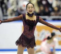 Crowd-pleasing performer: Mao Asada delights the crowd at Tokyo's Yoyogi National Gymnasium on Saturday, winning the women's program in the World Team Trophy. Mao earned 201.87 points to help Japan place third in the inaugural six-nation tournament. | KYODO PHOTO