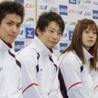 High hopes: (From left) Junya Koga, Ryosuke Irie and Aya Terakawa line up Monday as the JASF presents its squad for the World Swimming Championships in Rome. | KYODO PHOTO