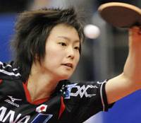 Table manners: Kasumi Ishikawa plays a shot against world No. 1 Zhang Yining on Sunday. | KYODO PHOTO
