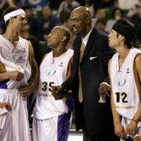Winning touch: Apache coach Joe Bryant (in suit), seen speaking to Nick Davis, John 'Helicopter' Humphrey and Jumpei Nakama, has guided the bj-league team to the playoffs in three of its four seasons. Bryant, the only coach in team history, hasn't signed a contract for the 2009-10 season. | AP PHOTO