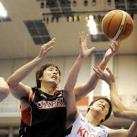 Time for a change: Japan national team power forward Kosuke Takeuchi (left) and his teammates, all of whom play in the JBL, would benefit from facing stiffer competition on a regular basis. | KYODO PHOTO