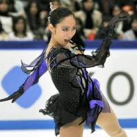 Hats off: Miki Ando performs in the women's short program at the NHK Trophy at Nagano's Big Hat on Friday. | KYODO PHOTO
