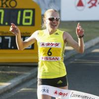 Going the distance: Inga Abitova crosses the finish line to win the Yokohama Women's Marathon on Sunday. Abitova finished in 2 hours, 27 minutes, 18 seconds. | KYODO PHOTO