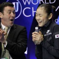 Teamwork: Coach Brian Orser and Kim Yu Na have a good working relationship based on mutual trust. | AP PHOTO