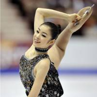 Elegance personified: Reigning world champion Kim Yu Na, the favorite to win the Olympic gold medal at the Vancouver Games next year, trains with coach Brian Orser in Toronto. | KYODO PHOTO