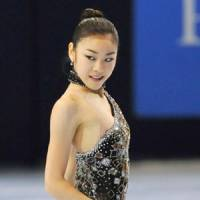 Goldfinger: World champion Kim Yu Na is the favorite to win this week's Grand Prix Final in Tokyo. | KYODO PHOTO