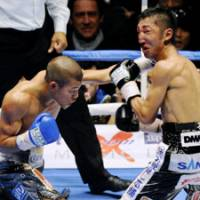 Brutal reality: Daisuke Naito (right) was pounded into submission by Koki Kameda in their WBC flyweight title bout on Nov. 29 in what may have been Naito's final fight. | KYODO PHOTO