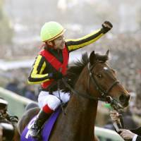 I have a dream: Kenichi Ikezoe punches the air after winning the Arima Kinen atop Dream Journey on Sunday. | KYODO PHOTO