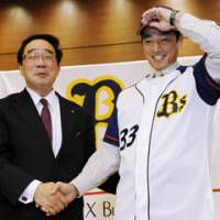 At what cost?: Outfielder So Taguchi's return to Japan with Orix has likely signaled the end of slugger Tuffy Rhodes' tenure with the Buffaloes. | KYODO PHOTO