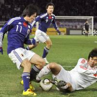 Still waiting: Keiji Tamada has been a regular in Takeshi Okada's national team without ever fully convincing. | KYODO PHOTO