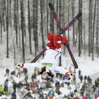 Back for more: Aiko Uemura flips during Sunday's World Cup meet in Inawashiro, Fukushima Pref. | KYODO PHOTO