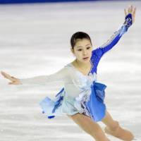 Up and coming: Kanako Murakami rallies to win the ladies world junior championship on Saturday in The Hague. | KYODO PHOTO