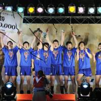Pay day: The Panasonic Panthers celebrate their win over the Sakai Blazers to clinch the men's Premier League final on Sunday. | KYODO PHOTO