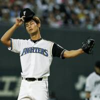 Little help please: Fighters ace Yu Darvish has pitched well over the past four weeks but poor run support has left him with no wins to show for it. | KYODO PHOTO
