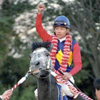 Legendary horse: Oguri Cap, ridden by star jockey Yutaka Take in December 1990 in the Arima Kinen, died on Saturday. He was 25. | KYODO PHOTO