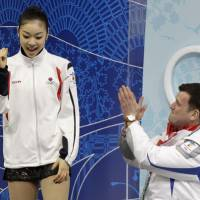 Nothing lasts forever: Olympic champion Kim Yu Na and Brian Orser, seen here after the short program at the Vancouver Games, have endured an acrimonious split. | AP PHOTO