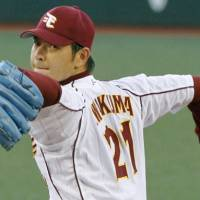 Outbound: Tohoku Rakuten ace Hisashi Iwakuma is ready to leave Japan to compete in the major leagues. The Eagles say they have no plans to post him. | KYODO PHOTO