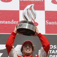 Start your engines: Ferrari driver Fernando Alonso hopes to improve his chances of winning the F1 title at the Japanese Grand Prix on Sunday. | AP PHOTO