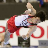 Uchimura wins parallel bar bronze for fourth medal