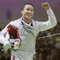 Leading the way: Yuki Ota helps Japan earn a bronze medal in the team foil event at the World Fencing Championships in Paris. | KYODO PHOTO
