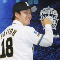 Hoping for big things: The Fighters are expecting draft pick Yuki Saito to help the bottom line both on and off the field. | KYODO PHOTO