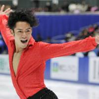 Defending champion Daisuke Takahashi performs his short program at the national championships on Friday in Nagano. Takahashi got off to a got off to a shaky start and trails in fourth place. | KYODO PHOTOS