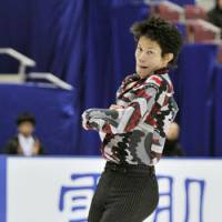 Stellar outing: Takahiko Kozuka skates during the men's short program at the national championships.