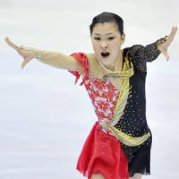 Golden girl: Kanako Murakami performs at the Asian Games on Saturday in Astana, Kazakhstan. Murakami won gold. | KYODO PHOTO