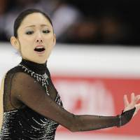One step higher: Miki Ando performs her free program at the Four Continents in Taipei on Sunday. Ando won with a personal best of 134.76 points.   KYODO PHOTO