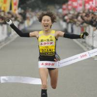 Sunday best: Yoshimi Ozaki crosses the finish line at the Yokohama Women's Marathon on Sunday. | KYODO PHOTO
