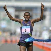 No distance left to run: Ethiopia's Hailu Mekonnen crosses the finish line to win the Tokyo Marathon on Sunday. | KYODO PHOTO